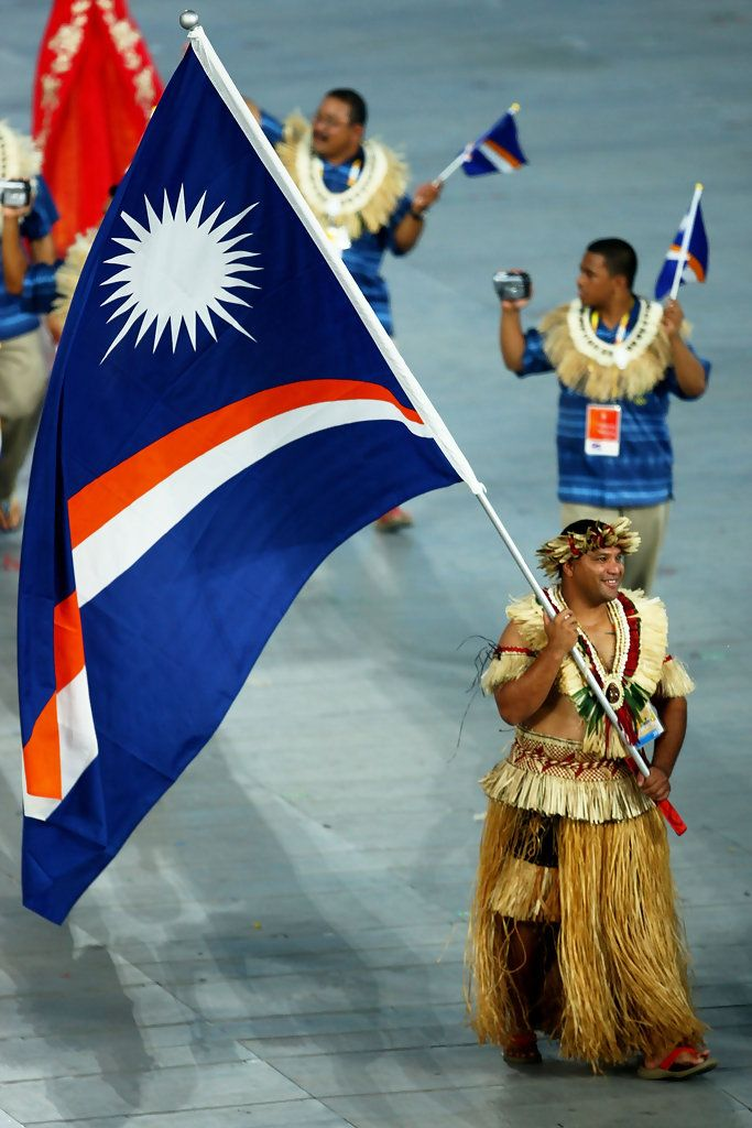 Waylon Muller of the Marshall Islands carries his country's flag during the Opening Ceremony for the 2008 Beijing Summer Olympics at the National Stadium on August 8, 2008 in Beijing, China.