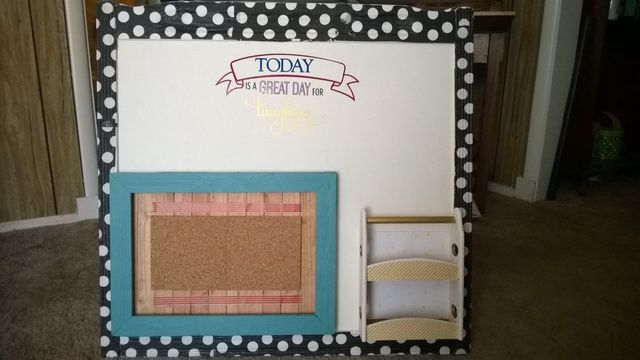The end of an old crib, a photo frame, cork, and spice rack. After decorating the frame and building a back for it, the pair were attached to the crib with hot glue gun. Polka dots are napkins, applied with mod podge. It says Today is a Great Day for Laughing, made with my Silhouette. Spice rack is charging station, or could be for holding notepad and push pins.