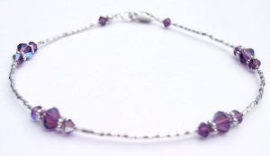 Damali .925 Sterling Silver Anklets Amethyst - February Swarovski Crystal Ankle Bracelets - MEDIUM 9.5 In. Damali. $49.95. Secure lobster clasp closure. Genuine freshwater pearls. Genuine Swarovski Austrian Crystals. Adjustable 1 Inch chain extenstion included. .925 Sterling Silver