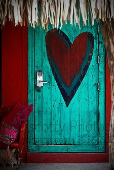 An artistically painted door in Sayulita, Mexico. Sayulita is a small surfing and fishing village about 25 miles north of downtown Puerto Vallarta in the state of Nayarit, Mexico
