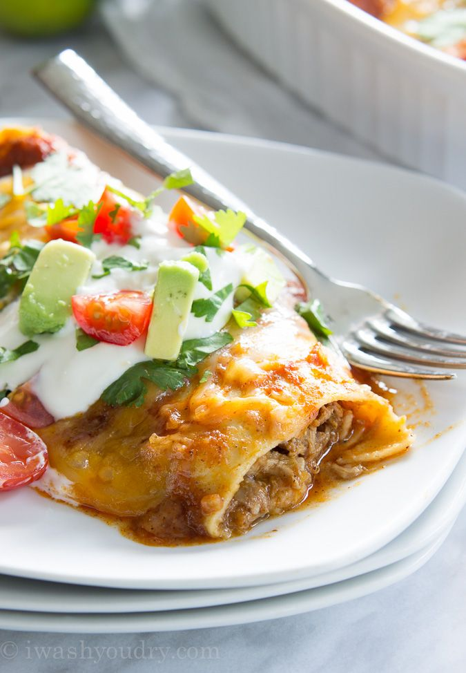 Sweet Pulled Pork Enchiladas with homemade enchilada sauce… these are to die for!!