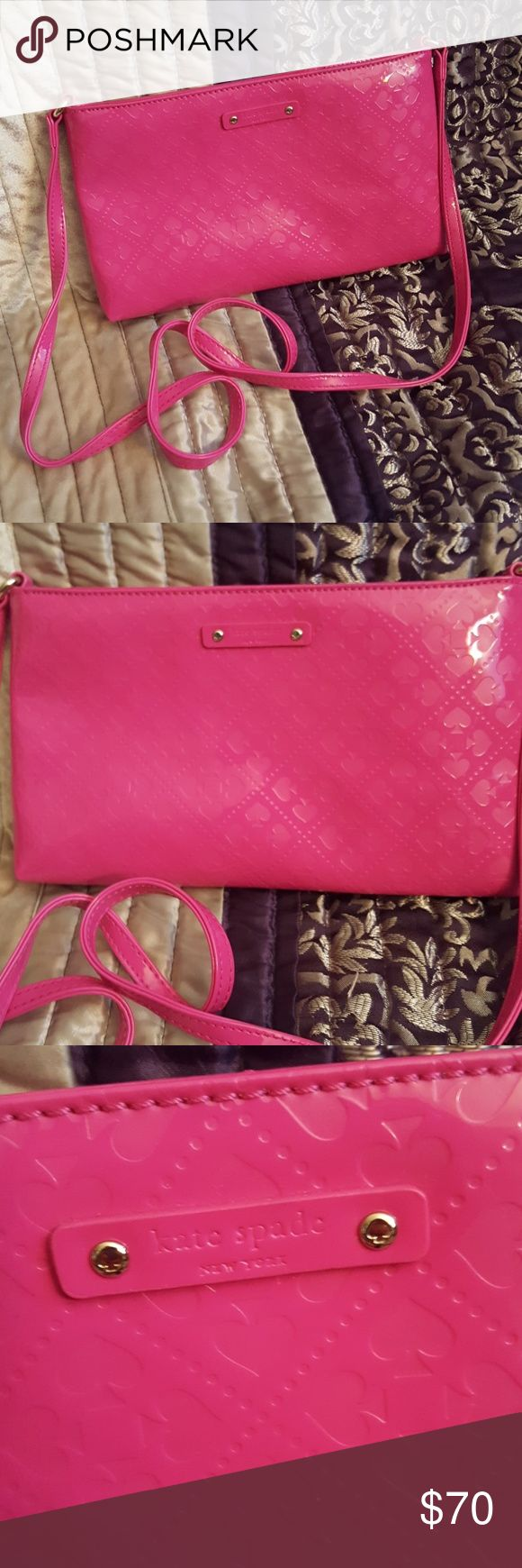 "NWOT Kate Spade Pink Crossbody Purse NWOT Kate Spade Pink Crossbody Purse. Brand new, never worn. Cute pink patent leather leather crossbody bag. Has a spade pattern and zippered closure. Interior has 4 credit card like slip pockets. Gold hardware. DIMENSIONS: 10"" L x 1.25"" W x 6"" H, strap drop about 24.5"". Check out my other kate spade purses, I have another one just like this in red with a bow on it! Check out my other kate spade bags and purses for sale!! kate spade Bags Crossbody Bags"