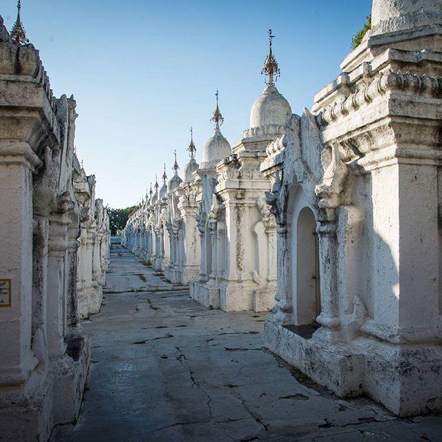 "The ""world's largest book"" at Kuthodaw Pagoda in Mandalay houses 729 marble slabs with sacred buddhist texts in as many white stupas. . . . . . #travelstoke #wanderlust #travel #backpacking #exploretheworld #myanmar #backpackingmyanmar #worldnomads #beautifuldestinations #mandalay #ichosetowander #exploremore #kuthodawpagoda #worldslargestbook #buddhism #instatravel #pagoda by tea_traveller. worldslargestbook #travelstoke #travel #ichosetowander #wanderlust #backpackingmyanmar #backpacking…"