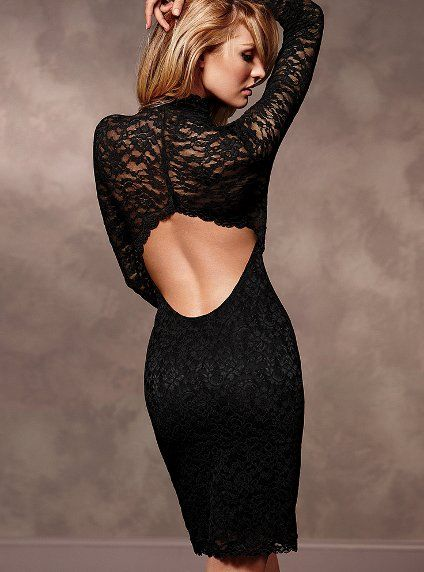 Black Lace Sexy Dress. Sleek and form fitting, with a super-sexy open back. Turtleneck. Imported nylon/spandex.