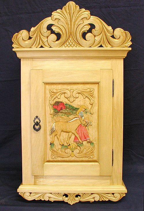 Norsk Wood Works -- Wall Cabinet made from basswood & the design in the door panel features a girl leading a fjord foal. ♥