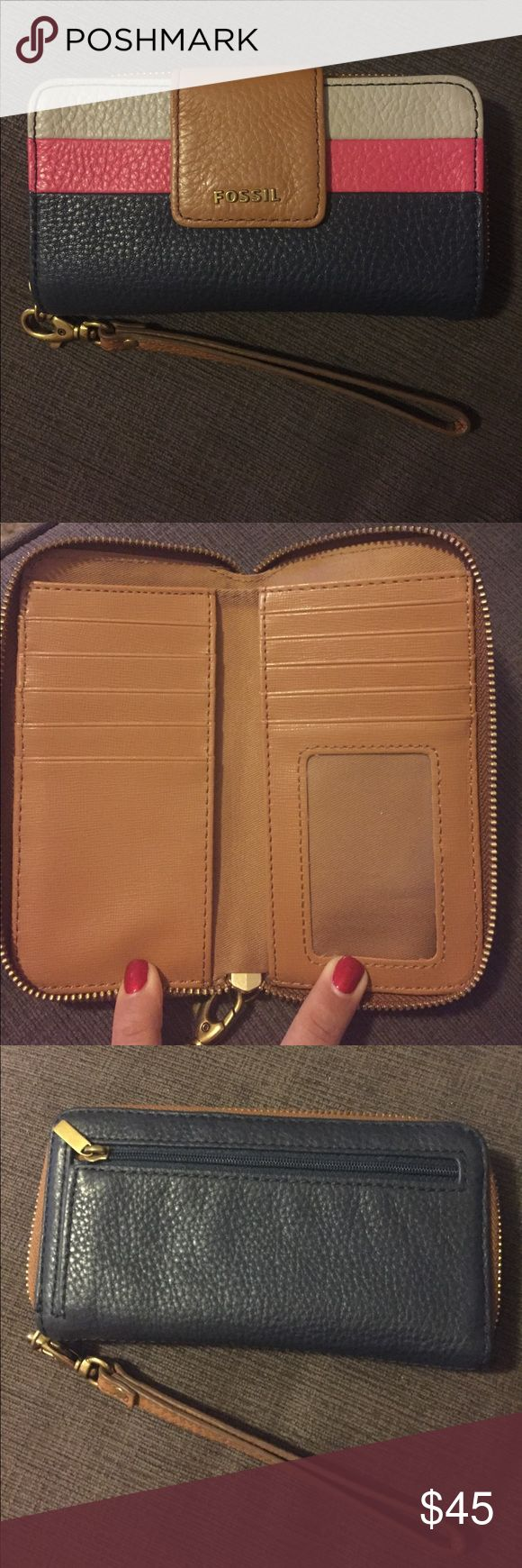 Fossil wallet Leather Fossil wallet with wrist strap, zip closure, many slots for cards and pocket for cash inside, zip pocket for change outside, outside pocket with button closure tab for cell phone. Barely used, excellent condition. Fossil Bags Wallets