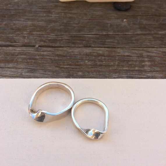 These solid sterling mobius bands are a matching set for a man and woman.    They are both forged from solid sterling silver, 4 mm wire and twisted to present the mystery of the mobius strip, a never ending symbol of eternity. Perfect for couples.    Man's ring  UK/Australian size U  US size 10 1/2    Woman's ring  UK/Australian size O  US size 7    These rings can also be purchased separately,  Free shipping included | Shop this product here: http://spreesy.com/SilverPinions/99 | Shop all…