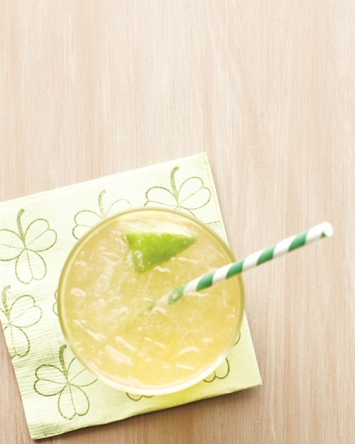 Irish Buck - 2 ounces Irish whiskey; 1 tablespoon fresh lime juice; 3 ounces ginger ale; Lime wedge; ice