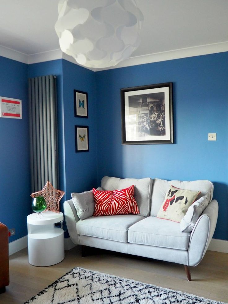 Bright Blue walls - love the colour of this room with the French Connection sofa!