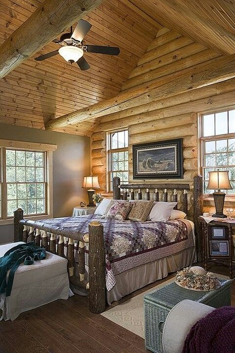 Log cabin master bedroom with log bed frame. Very attractive.