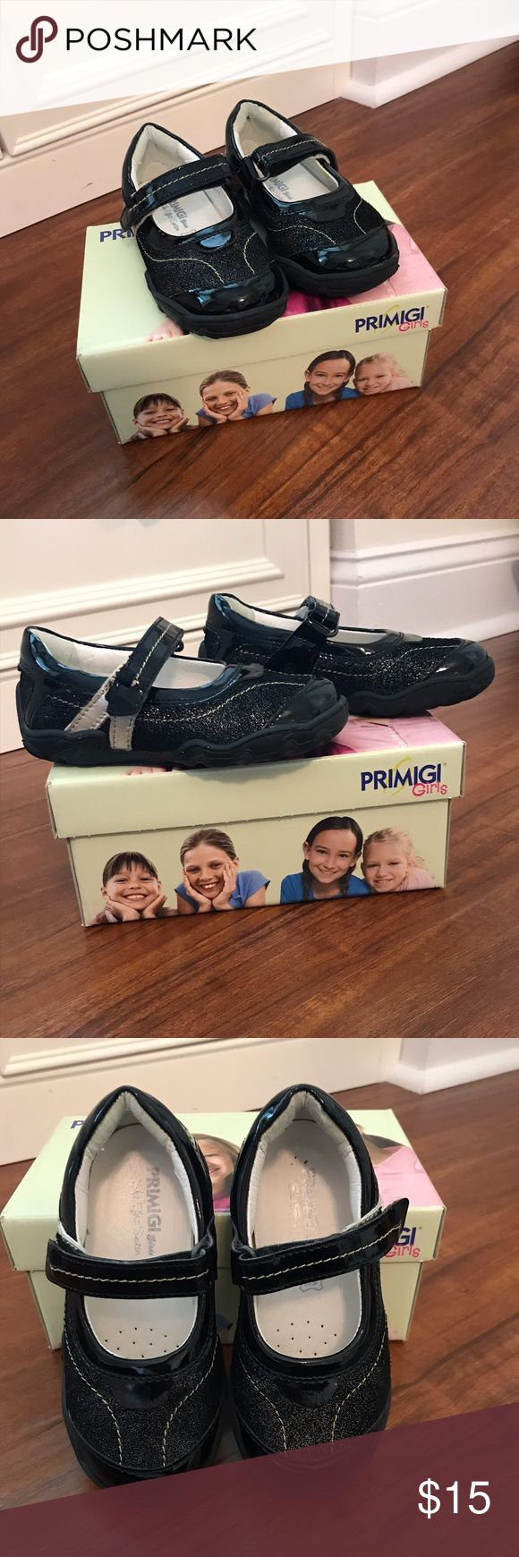 Primigi Phoebe Mary Janes Black Baby Sz 7 These Primigi Phoebe mary janes in black (Eur 24/approx US 7) are cute and casual for dress and play.   With synthetic upper and lining, metallic black is complemented by patent leather and gold accents.  Has Velcro® strap for easy on and off, removable insole and a flexible rubber sole. Removable insole. Primigi Shoes Baby & Walker