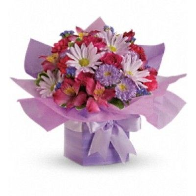 This pretty purple present comes with a beautiful surprise - a lovely bouquet of flowers that's perfectly arranged and wrapped to look like a present. The soft lavenders, pinks and purples make this a wonderfully feminine gift.