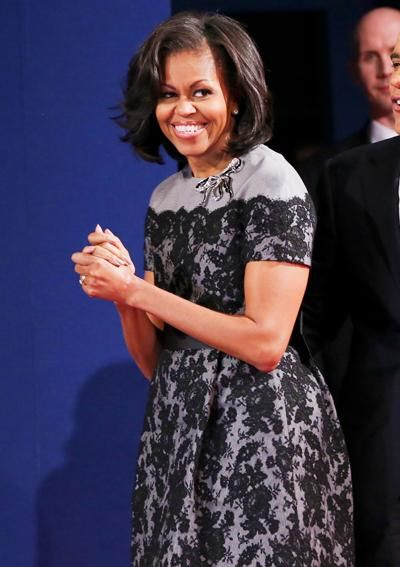 Michelle Obama's Best Looks Ever - 2012 - Thom Browne from #InStyle   Michelle Obama chose to repeat a grey Thom Browne dress with black lace overlay punctuated by an oversized bow-shaped brooch, for President Obama's third and final presidential debate.