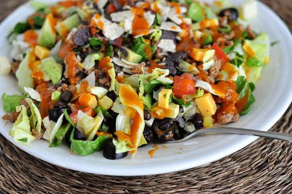 This chopped taco salad with homemade catalina dressing comes together in less than 30 minutes and is the perfectlight and refreshing meal for the heat of summer.