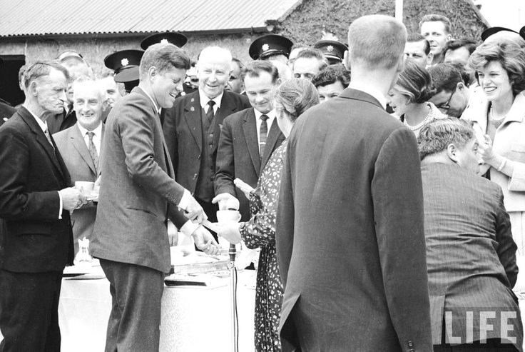 US President John F. Kennedy (3L) serving food to his Irish cousin Mary Ryan (floral print) during an outdoor tea party in his ancestral hometown during a visit to Dunganstown, Wexford, Ireland  Ireland.1963 ❤❁❤❁❤❁❤❁❤❁❤ http://en.wikipedia.org/wiki/JFK_in_Ireland http://www.nps.gov/jofi/index.htm  http://www.nps.gov/nr/travel/presidents/john_f_kennedy_birthplace.html  http://en.wikipedia.org/wiki/John_F._Kennedy