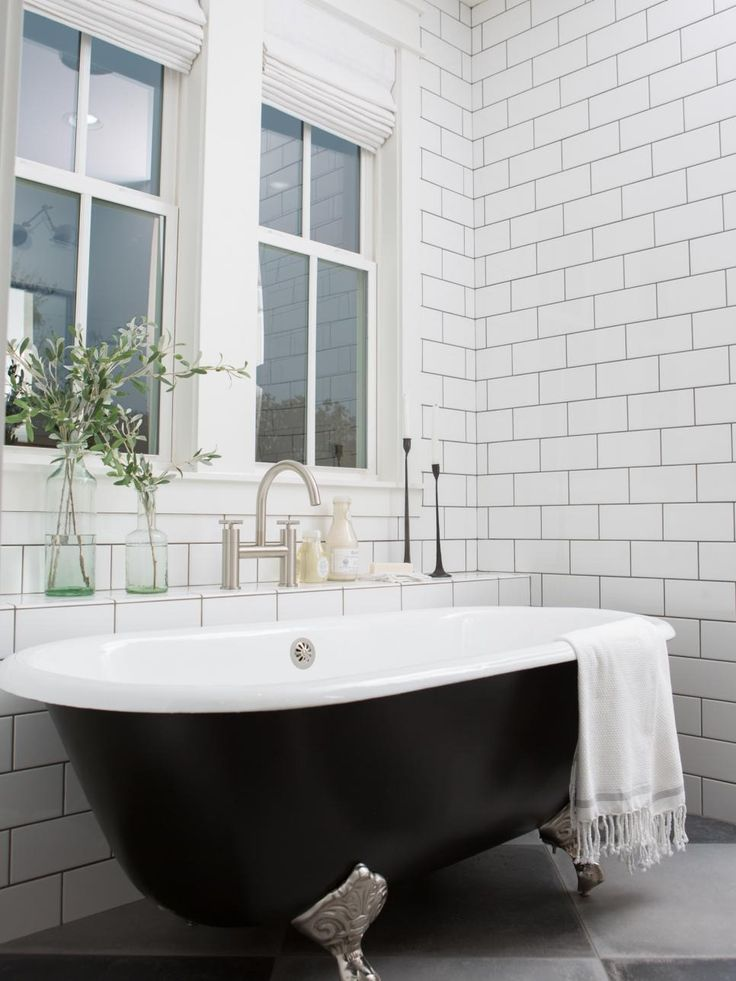 Chip and Joanna Gaines  transform a shack for the Fixer Upper show producer Michael Matsumoto and his wife. The transformation combines the rustic appeal they wanted with modern accents throughout, like this   black painted clawfoot tub and sleek deck-mount tub faucet. Shop the look at Signature Hardware with the Sanford Cast Iron Clawfoot Tub, Exira Deck-Mount Tub Faucet, and Exira Wall-Mount Bathroom Sink Faucets.