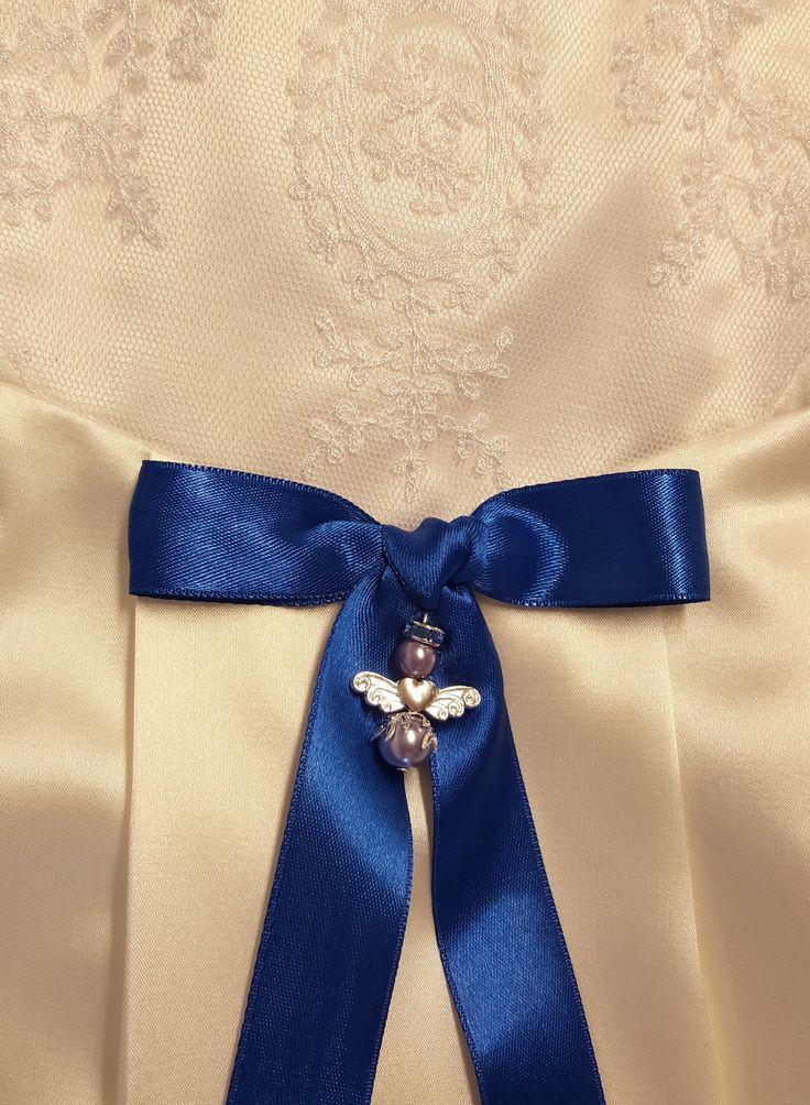 Vacker doprosett med skyddsängel till vår exklusiva dopklänning.