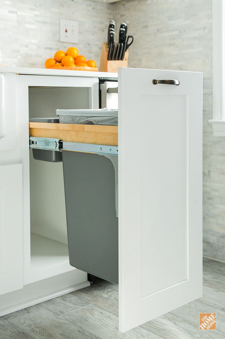 Make efficient use of valuable kitchen floor space with a Thomasville Base Waste Basket. It's just one of many kitchen organization solutions you can choose when you use Thomasville Cabinets in your kitchen makeover. Click through to see more of the Thomasville space savers in this kitchen renovation.