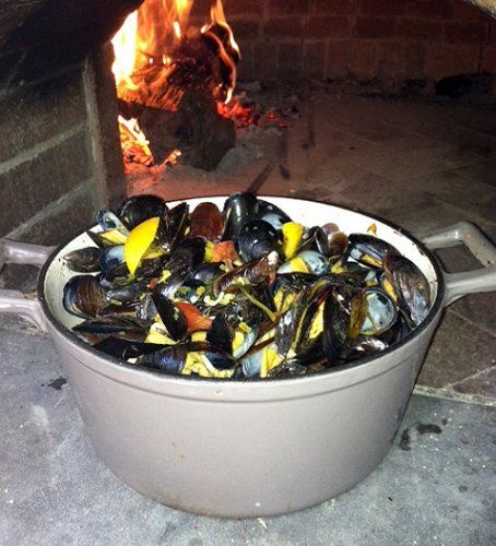 Pot of mussels in a wood-fired oven