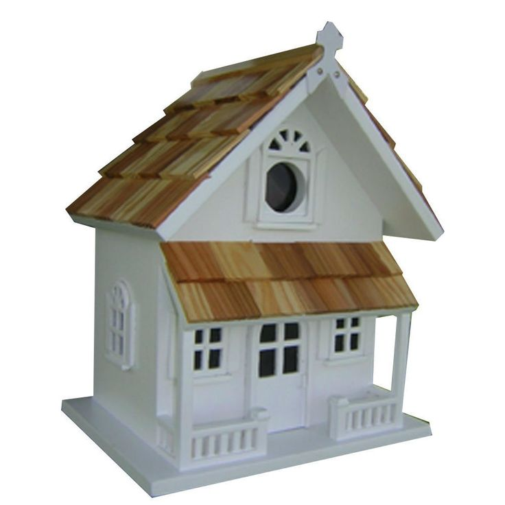 "A pine shingled roof, a covered porch and ""Cottage"" styling give this White Victorian Cottage Wooden Birdhouse - Fully Assembled plenty of charm. A removable back wall, drainage, ventilation, an unpai"