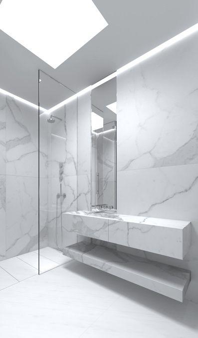 Mármore branco é o acabamento ideal para quem deseja um banheiro contemporâneo. Inclusive na bancada e prateleira.