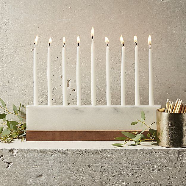 Haute Hanukkah. Crafted from Vermont marble and fitted with a walnut wood base, streamlined structure celebrates contemporary holiday style. When used with CB2 menorah candles, use candle buttons due to hole size variance.