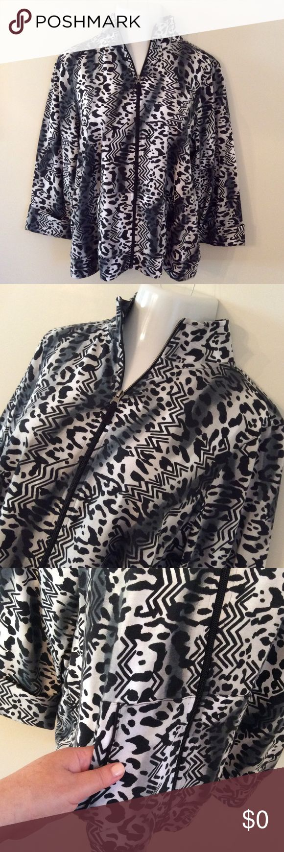 | casual TRIBAL animal print zip up jacket | In New Condition!  Stylish Animal Print, Zip up Jacket. Front Pockets and Mock Neck. Long Sleeves. Material is 57% Cotton, 38% Polyester and 5% Spandex. Kim Rogers Jackets & Coats