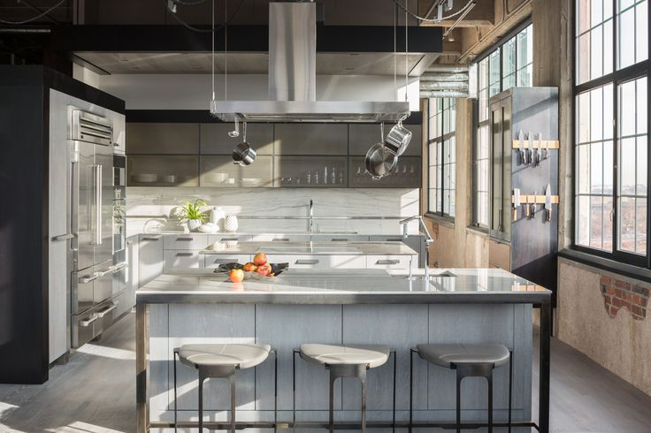 A historic building in Denver houses this modern loft, which was given a complete remodel by architect Robb Studio and interior design firm Studio Gild.