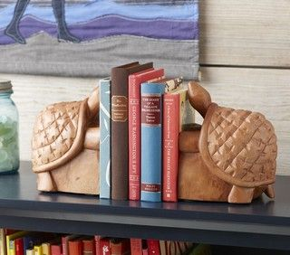 These turtle bookends are great for your little bookworm. Carved from solid wood, they have a hint of island flair in their design. The price is for a set of