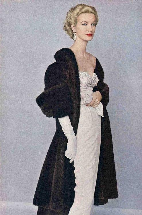 Sunny Harnett wearing a fur coat, 1952.