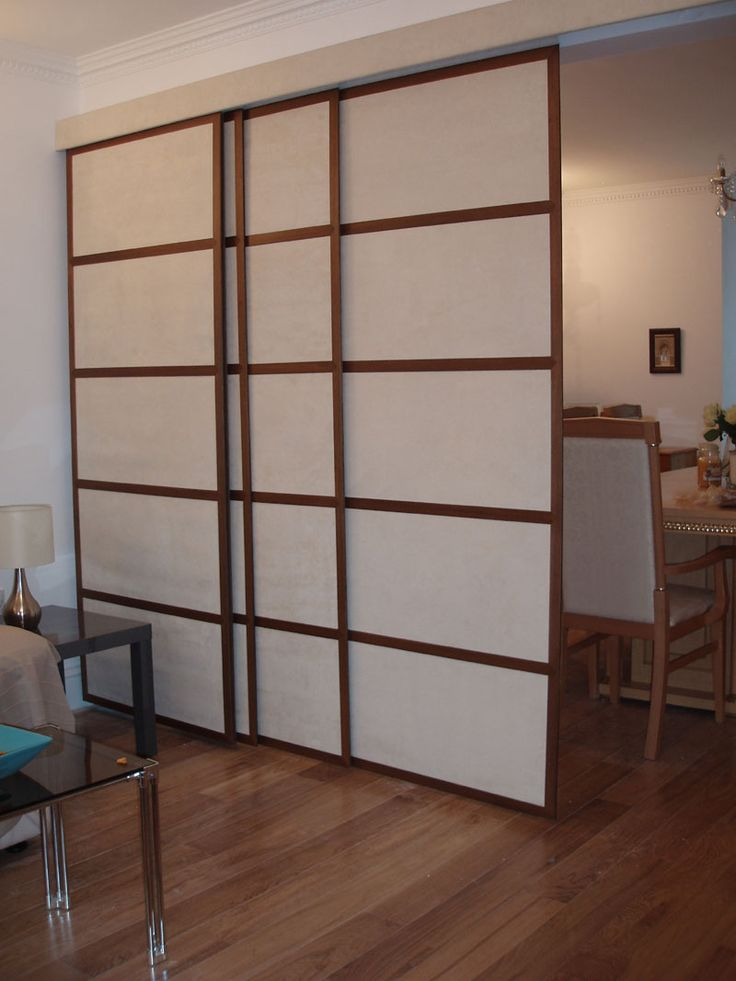 Japanese Room Divider Style Four Slide Door Panels On Brown Polished Mahogany Parquet Floor As Well