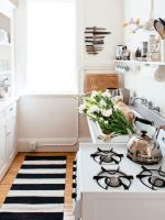 6 Swoon-Worthy Small Kitchens #refinery29  http://www.refinery29.uk/small-kitchen-ideas-interiors-tiles#slide-3  Another all-white kitchen, this time with a monochrome slant. Using a rug or runner in a kitchen instantly gives it a homely feel – after all, why shouldn't a bijoux cook space feel just as luxe as the rest of your home? Open shelving and a wall-mounted knife rack create extra storage and keep essential utensils close at hand for whipping up a culinary storm. Or just cutting up…