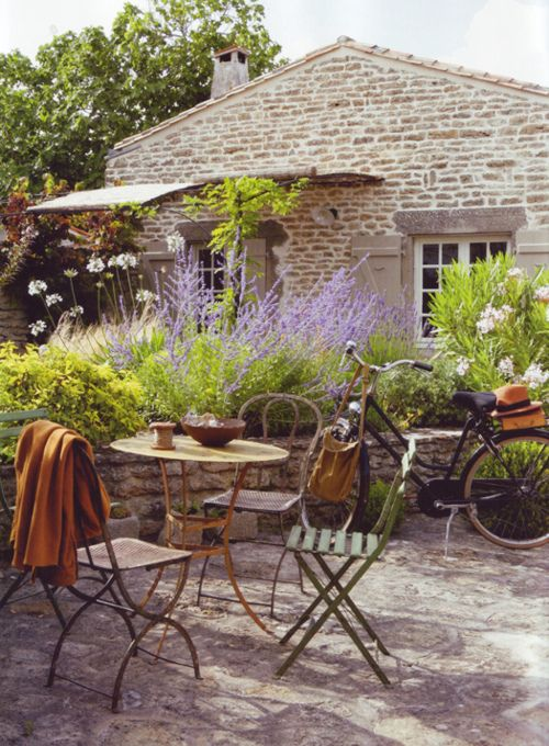 stop and chat... so inviting... lavender garden, cafe table, bicycle ready to ride.