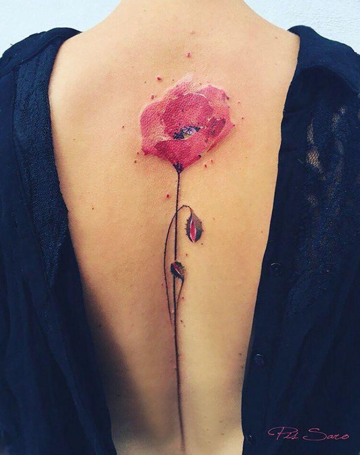 I like floral spine tattoos.