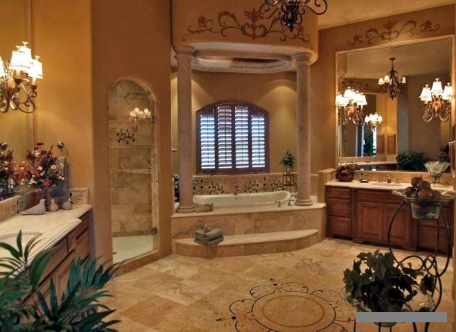 i like the elegance of this bathroom the arch way to the shower is beautiful