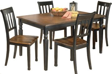 Ashley Owingsville Rectangular DRM Table and Four Chairs -The rich cottage beauty of the Owingsville dining collection uses a rich medium brown finish on chair seats and table tops contrasting the painted black color of the table base and chair legs to create a stylish two-tone cottage look that is sure to add a warm inviting atmosphere to any dining area.