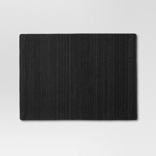 This simple Placemat from Threshold™ is the perfect functional accent to add to your dining room table. The elegant and clean design of this black cotton blend placemat makes it versatile, so you can use it with a variety of different decor styles. Pair this modern black placemat with brightly colored dishes and a fresh flower centerpiece to give your dining room table clean and contrasting style.