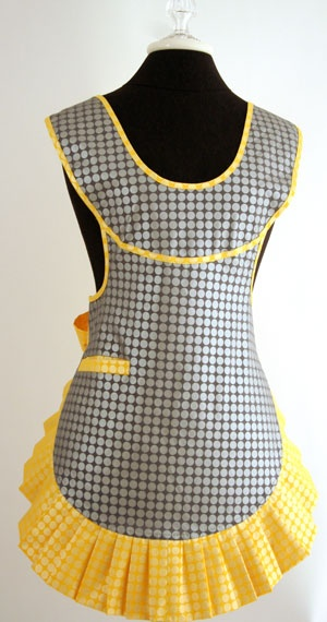 Cute aprons. Its funny, I don't collect things, I hate knick knacks, but man if I could have 2 dozen cute but different aprons and tons of different cookbooks I would be a very very happy person.
