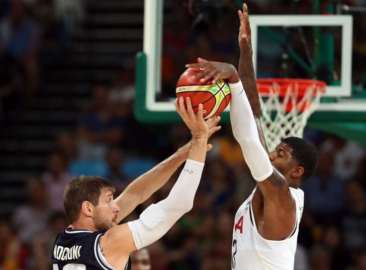 Argentina small forward Andres Nocioni (13) passes the ball against USA guard Paul George (13) during the men's basketball quarterfinals in the Rio 2016 Summer Olympic Games at Carioca Arena 1.