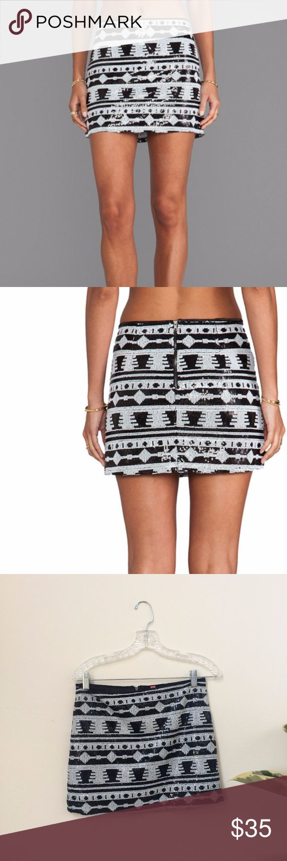 """White & Black Geometric Mini Skirt by Eight Sixty 100% poly Skirt measures approx 13.5"""" in length Fully lined Hand wash cold Sequined patterned throughout Center back zipper closure Revolve Style No. EIGH-WQ10 Manufacturer Style No. CZE88728  Eight Sixty features a modern collection of trendy prints in colorful palettes. Their tops and dresses feature ruffles and color blocks with fun trims and embellishments that are sure to catch your eye. Eight Sixty Skirts Mini"""