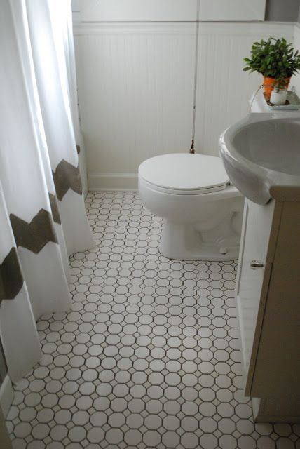 Bathroom Floors- love the pattern with the grey grout - saw a cheapy white porcelain one at rona that might look similar with grey grout.