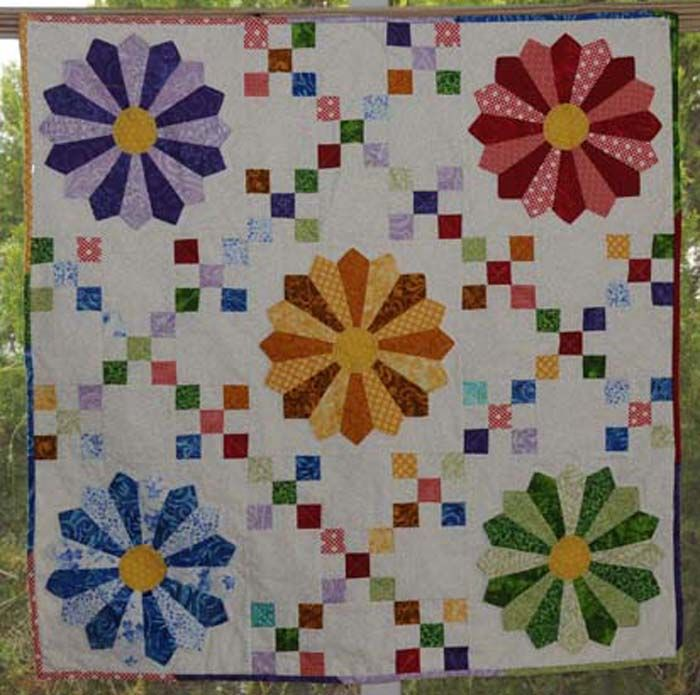 Plates in the 9 Patch Quilt Pattern KB-46 by Kay Buffington. Dresden plate quilt pattern. Advanced beginner.
