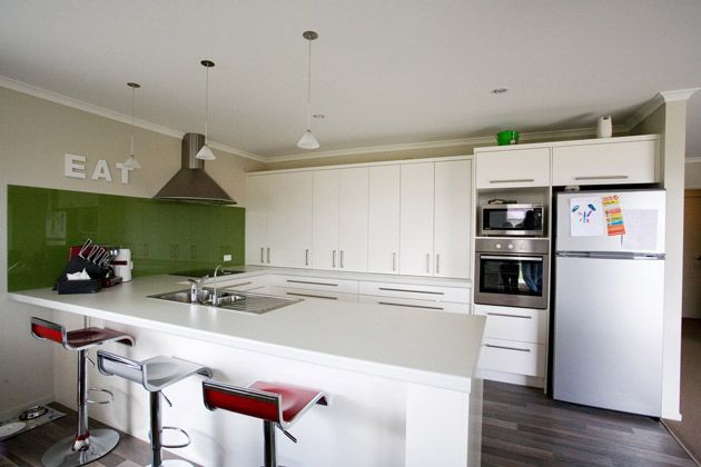 The Olive-Green splashback draws your eye in this kitchen, and leans towards a retro-feel. #ClassicBuilders #KitchenDesign