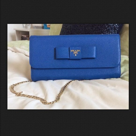 Royal Blue Prada Clutch Handbag Gorgeous blue Prada clutch with detachable gold chain strap for shoulder carrying. Small yet spacious with several interior sections for storage. Perfect bag to class up a day time or business outfit then easily transition into a timeless evening bag.   This bag exemplifies simplicity, elegance, and taste. The rich blue color adds a dramatic yet not overwhelming splash of color, a definite standout.  OG price $1280.00 Prada Bags Clutches & Wristlets