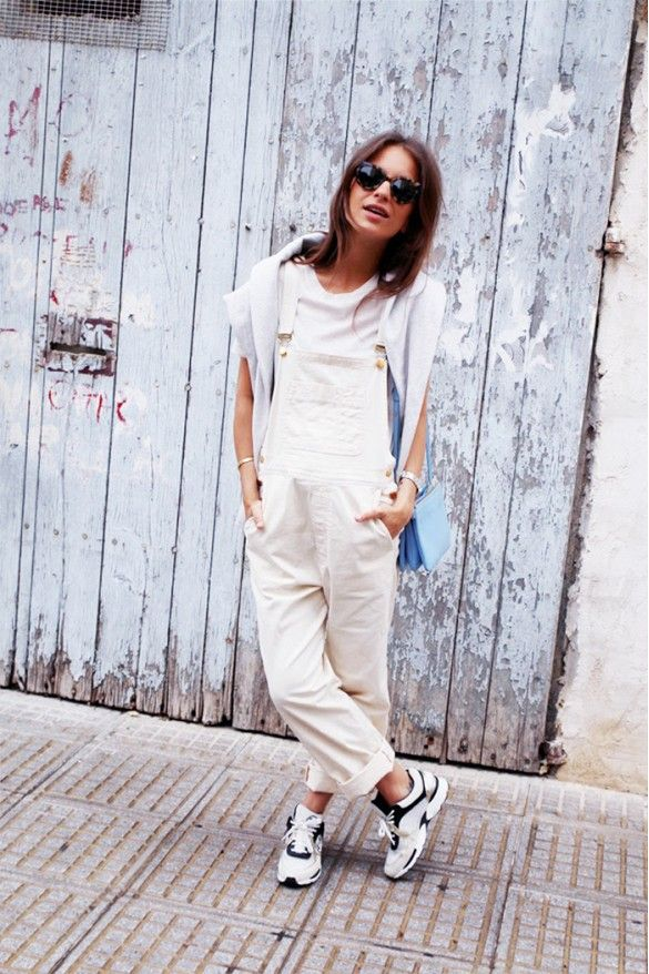 Neutral + baggy overalls paired with powder blue bag and sneakers