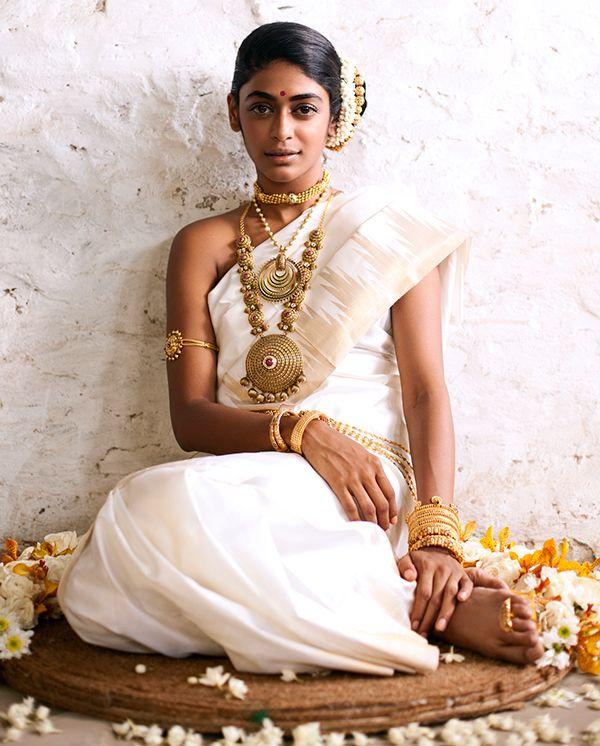 South Indian bride. Temple jewelry. Jhumkis. White silk kanchipuram sari. Side bun with fresh flowers. Tamil bride. Telugu bride. Kannada bride. Hindu bride. Malayalee bride.Kerala bride.Kerala Kasavu.