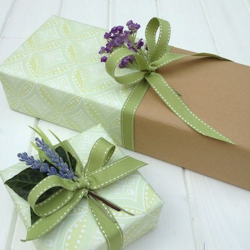 Joining papers for a dramatic gift wrapping effect.  Ribbons by #janemeans and green paper by #foxandlark