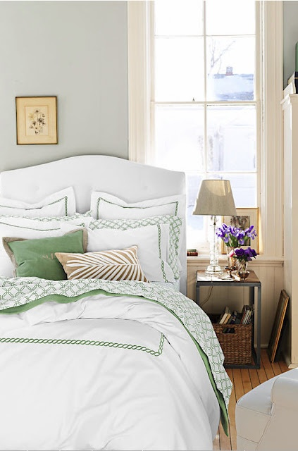 white bedding with a pop of green