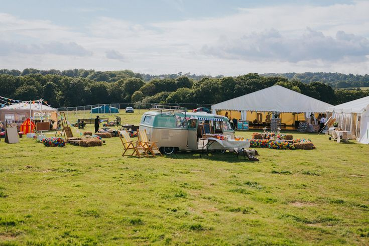 A great idea for reception drinks - serve them out of a VW camper van. Photo by Benjamin Stuart Photography #weddingphotography #receptiondrinks #vwcamper #festivalwedding #receptiondecor #party