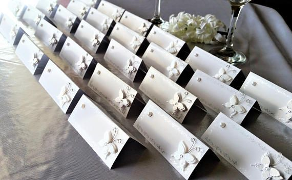 Classy white and silver accented butterfly and pearl name seating cards!